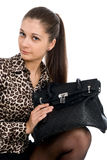 The young beautiful girl with a black handbag Stock Photo