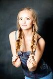 Young Beautiful Girl with Blond Braids. Natural Makeup Stock Image