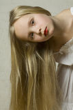 Young beautiful girl with blond hair Stock Image