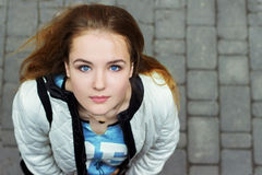 Young beautiful girl with blue eyes and red hair walking in the streets. Young beautiful girl with blue eyes and red hair walking Stock Images