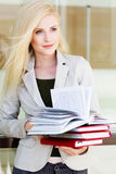 Young beautiful girl with a books Royalty Free Stock Photos