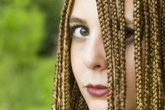 Young beautiful girl with braided hair stock photo