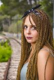Young beautiful girl with braided hair royalty free stock photography