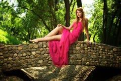 Young beautiful girl on a bridge Stock Photo