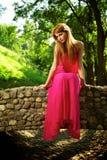 Young beautiful girl on a bridge Stock Photos