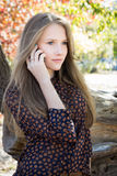 Young beautiful girl calling on mobile phone in park Royalty Free Stock Photography