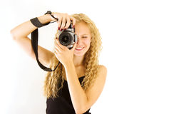 The young beautiful girl with the camera Royalty Free Stock Photos