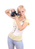 Young beautiful girl with the camera Stock Photography