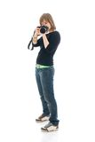 The young beautiful girl with the camera isolated Royalty Free Stock Photography