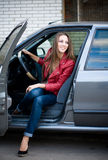 Young beautiful girl in car. Happy smiling woman. Stock Photo