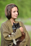 Young beautiful girl with a cat Royalty Free Stock Images