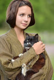 Young beautiful girl with a cat Stock Image