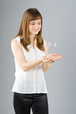 Young beautiful girl catch soap bubble Stock Photo