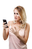 Young beautiful girl with cellphone in hands Stock Images