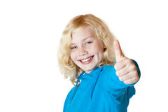 Young beautiful girl / child shows thumb up Stock Photo