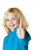 Young beautiful girl / child shows thumb up stock photos