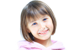 Young beautiful girl child smiles Royalty Free Stock Image