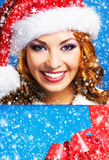Young and beautiful girl with a Christmas present Stock Photos