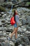 Young beautiful girl climbing the rock Royalty Free Stock Photo