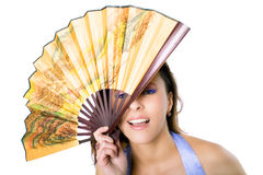 The young beautiful girl with color fan Royalty Free Stock Photography