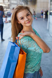 Young beautiful girl with colorful shopping bags. Season of sale Royalty Free Stock Image