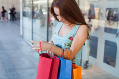 Young beautiful girl with colorful shopping bags. Season of sale Royalty Free Stock Images