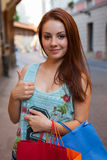 Young beautiful girl with colorful shopping bags. Season of sale Stock Photos