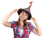 Young beautiful girl in colour hat Stock Images