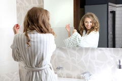 A young beautiful girl is combed Stock Images