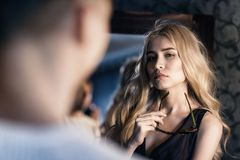 Young beautiful girl communicates with her man. Family relationships. Closeup royalty free stock photo