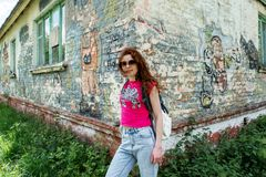 Young beautiful girl at the corner of old building in Ukraine Stock Photography
