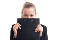 Young beautiful girl covers her face and looks into the Tablet Chamber isolated on white background. Young beautiful girl covers her face and looks into the royalty free stock photos