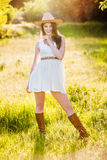 Young beautiful girl in a cowboy hat royalty free stock images