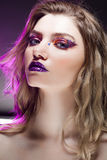 Young beautiful girl with creative make up. Attractive blonde, close-up Royalty Free Stock Photo