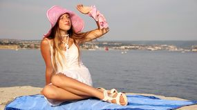 Young beautiful girl and a cruise ship Stock Images
