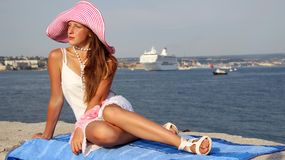 Young beautiful girl and a cruise ship Royalty Free Stock Images