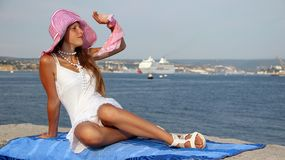 Young beautiful girl and a cruise ship Royalty Free Stock Photography