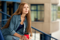 Young beautiful girl with a cup of coffee. Royalty Free Stock Photo