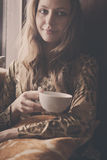 A young beautiful girl with a cup of tea Stock Photos