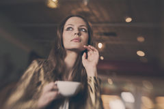 A young beautiful girl with a cup of tea Royalty Free Stock Photography