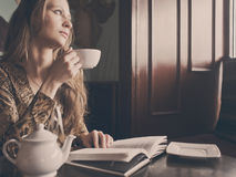 A young beautiful girl with a cup of tea Royalty Free Stock Image