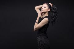 Young beautiful girl with curly hair. Beauty Model girl with Healthy curly black Hair royalty free stock images