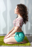 Young beautiful girl with curly hair sitting Stock Photography
