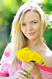 Young beautiful girl with dandelions Royalty Free Stock Images