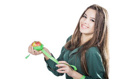 Young beautiful girl with dark hair isolated on a white background holding an apple with a tape measure.Smile. Woman hand with green apple and measure tape Royalty Free Stock Photography
