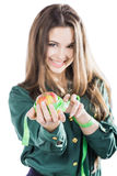 Young beautiful girl with dark hair isolated on a white background holding an apple with a tape measure.Smile. Woman hand with green apple and measure tape Royalty Free Stock Photos
