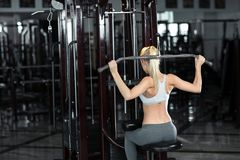 Young beautiful girl does exercises Royalty Free Stock Photo