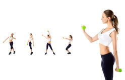 Young beautiful girl doing exercises with dumbbells. Royalty Free Stock Images