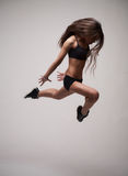 Girl doing gymnastick jump Royalty Free Stock Photos