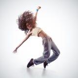 Girl doing gymnastick jump stock images
